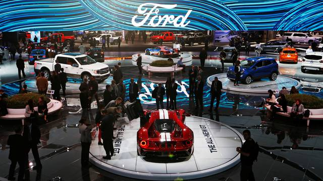 People walk through the Ford display during the North American International Auto Show in Detroit
