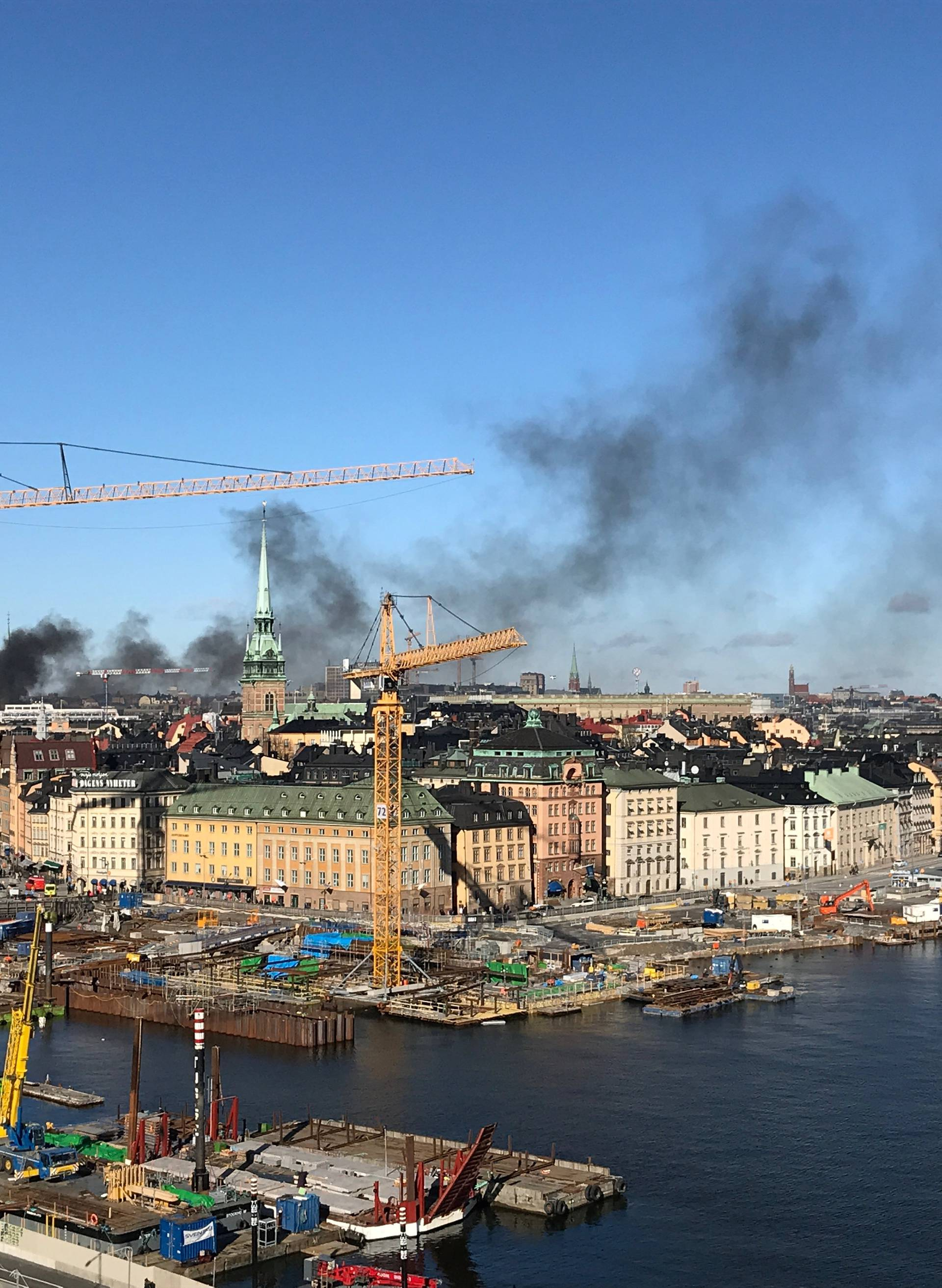 Smoke from a bus explosion and fire is seen in Tegelbacken in central Stockholm