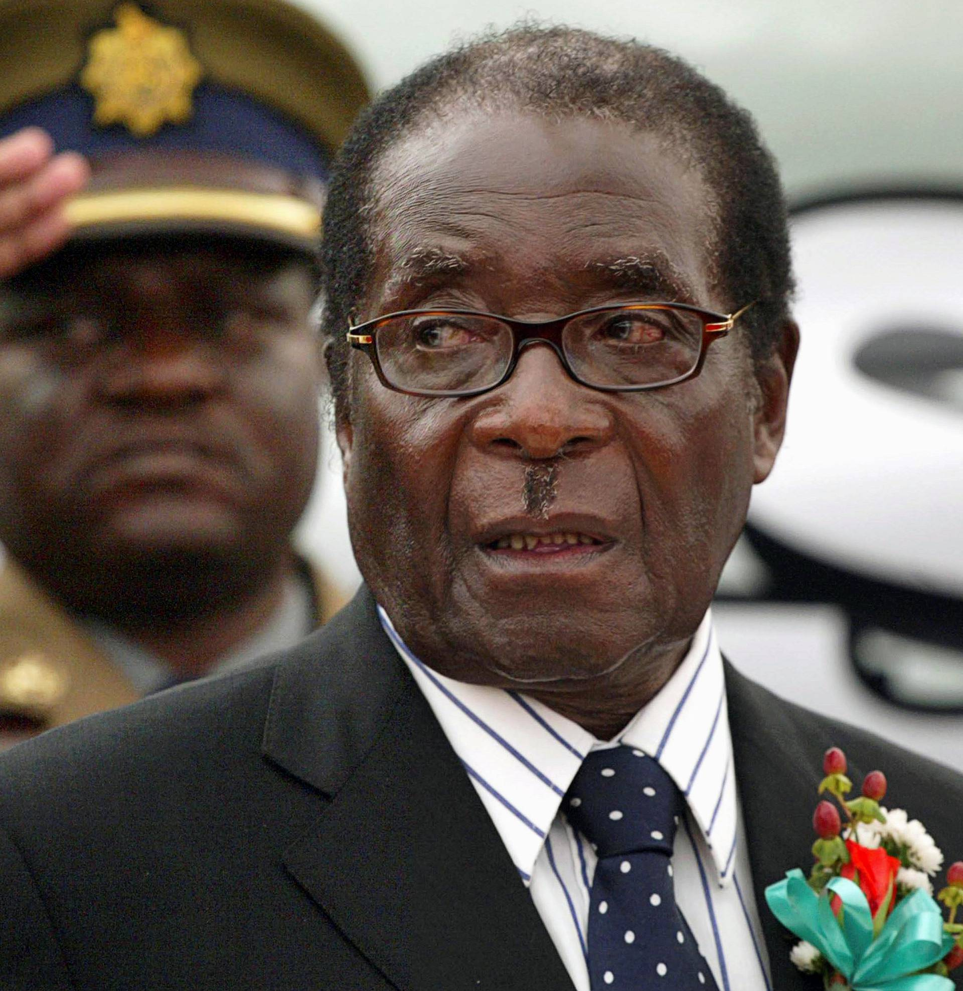 FILE PHOTO -  File photo of Zimbabwe President Mugabe attending the launch of basic commodities in Harare