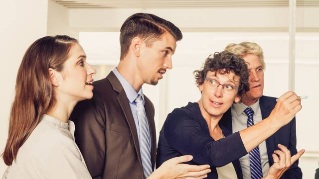 Serious businesspeople having discussion in office