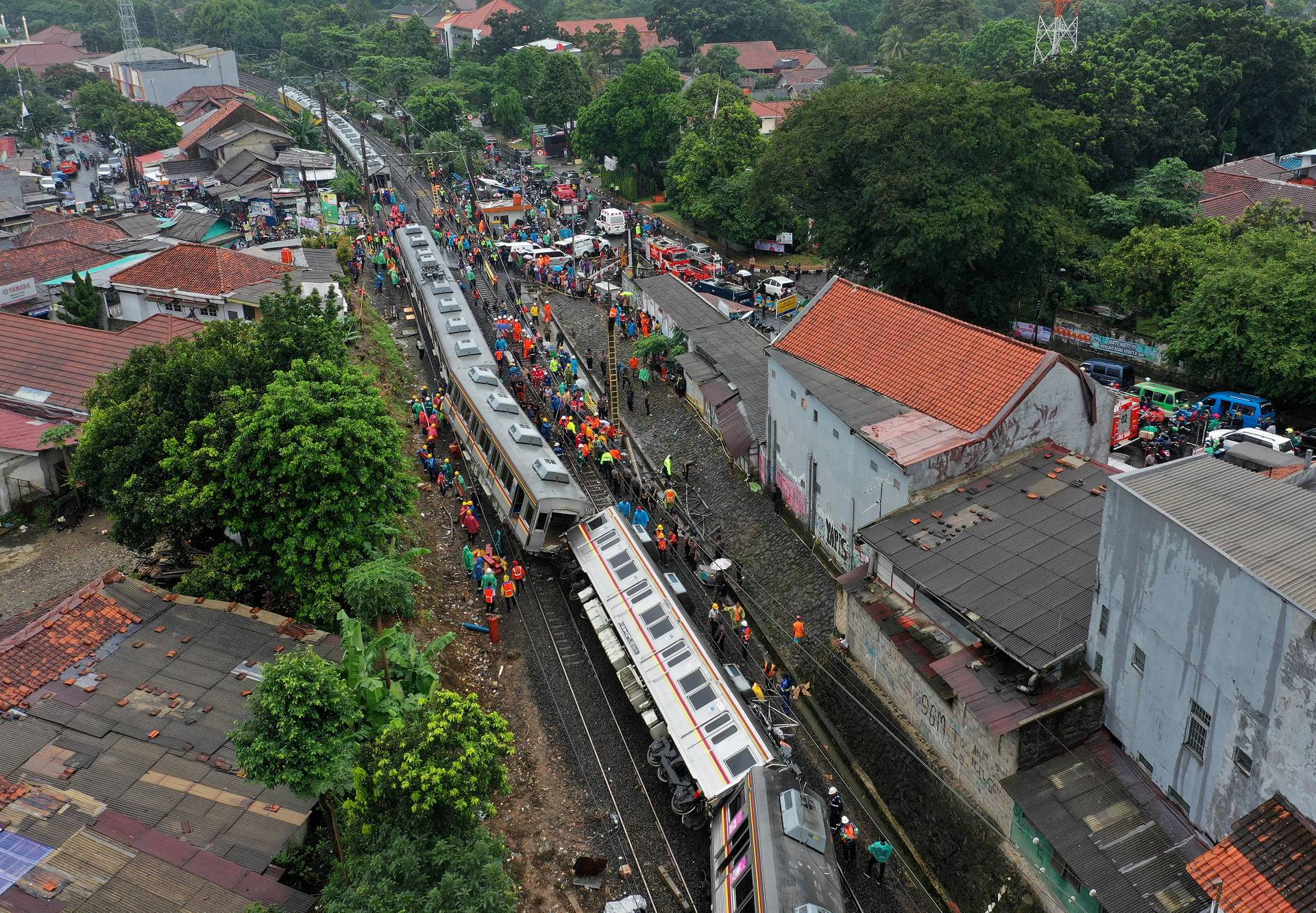 An aerial picture of a derailed commuter train in Bogor, West Java province
