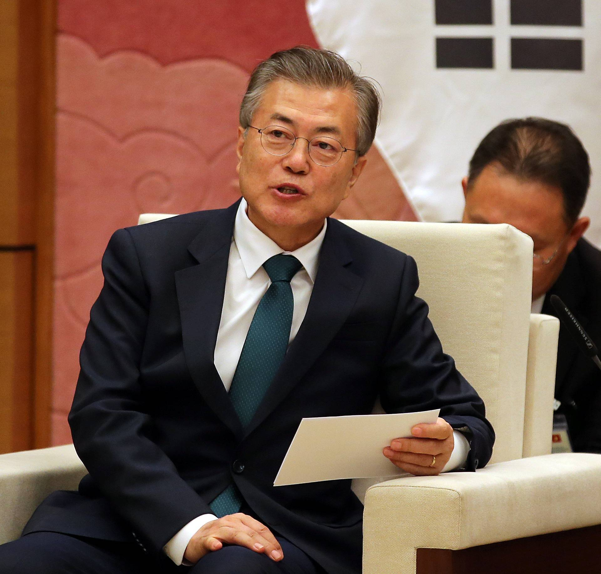 South Korean President Moon Jae-in talks to Vietnamese Chairwoman of the National Assembly Nguyen Thi Kim Ngan at the National Assembly in Hanoi