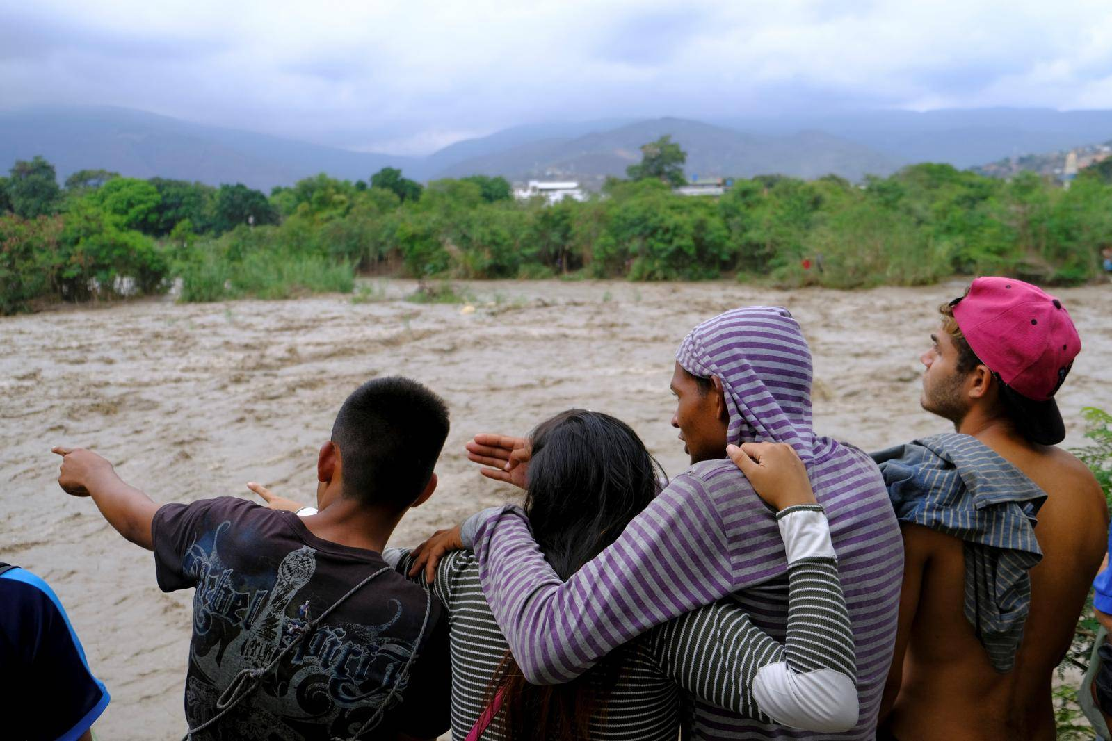 People look towards the Tachira River on the border between Colombia and Venezuela, in Cucuta
