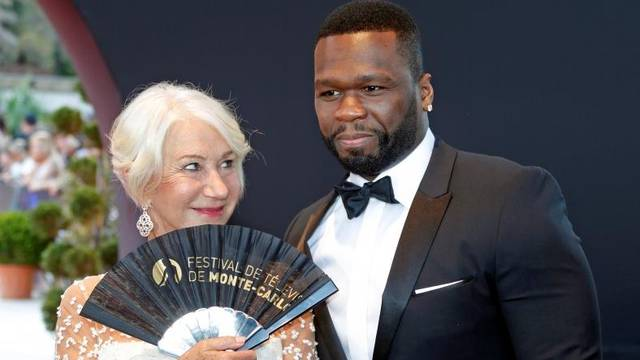"""Actor Mirren poses with actor and singer """"50 Cent"""" before the closing ceremony of the 57th Monte-Carlo Television Festival in Monaco"""