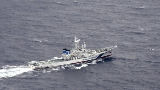 A Japan Coast Guard patrol vessel sails on the water at the area where two U.S. Marine Corps aircraft have been involved in a mishap in the skies, off the coast of Kochi prefecture, Japan