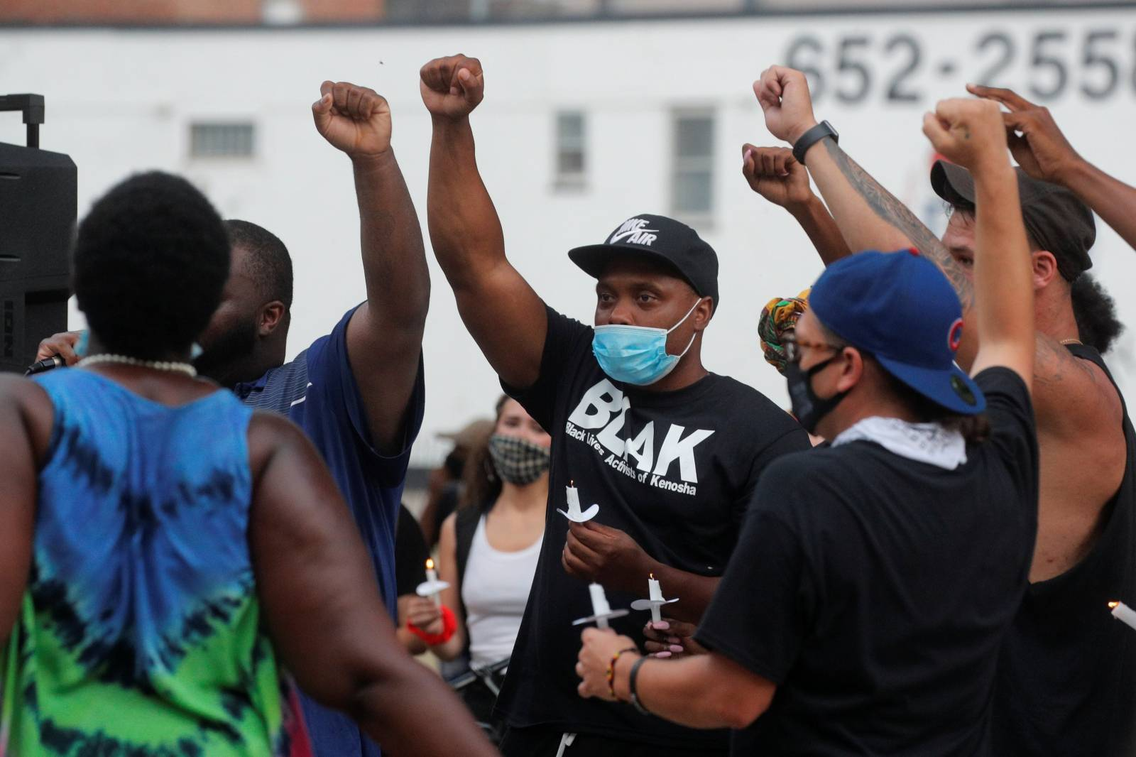 People react while gathering for a vigil, following the police shooting of Jacob Blake, a Black man, in Kenosha, Wisconsin