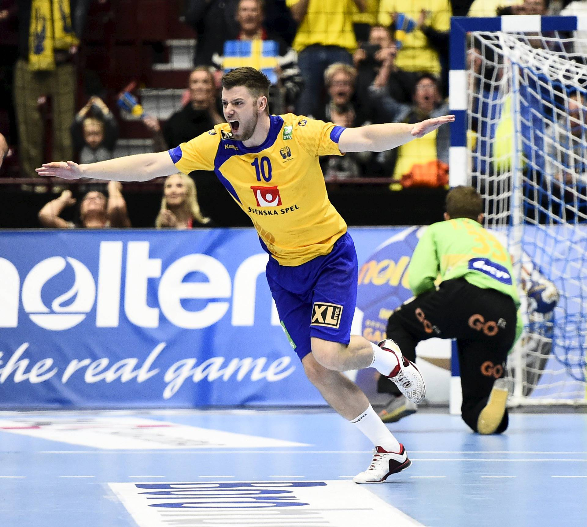 Sweden's Niclas Ekberg celebrates after scoring a penalty during the men's handball Olympic Qualification Tournament group 2 match against Spain at Malmo Arena in Malmo