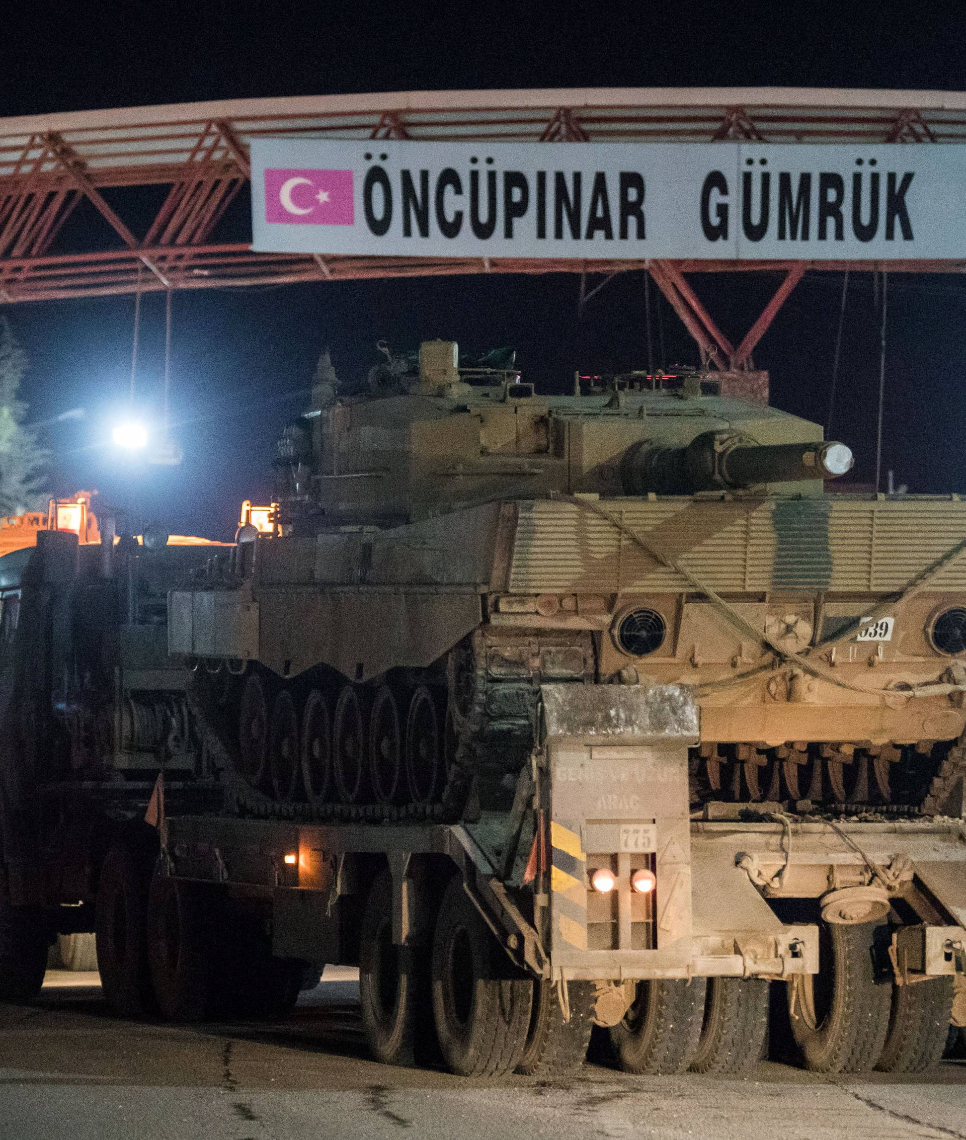 Turkish military vehicles cross into Syria at Oncupinar border gate in Kilis