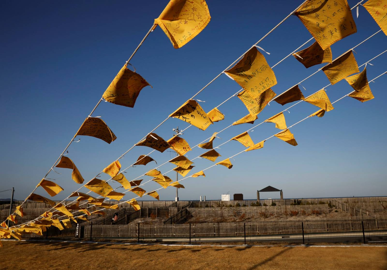 Yellow handkerchiefs with messages supporting people in areas hit by the 2011 earthquake and tsunami are hanged ahead of the 10th anniversary of Fukushima disaster, in Iwaki