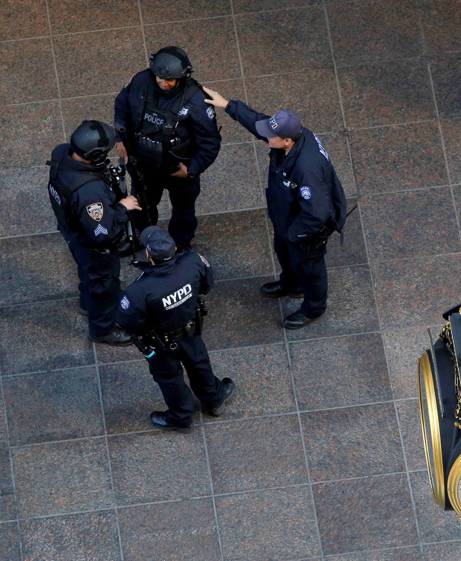 Members of the New York Police Department's Counterterrorism Bureau stand guard outside Republican presidential nominee Donald Trump's Trump Tower in Manhattan, New York, U.S.