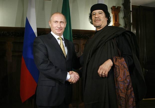 Terorizam i njegovi oblici - Page 3 Vladimir_putin_and_muammar_gaddafi_in_moscow_1_nov_2008-1
