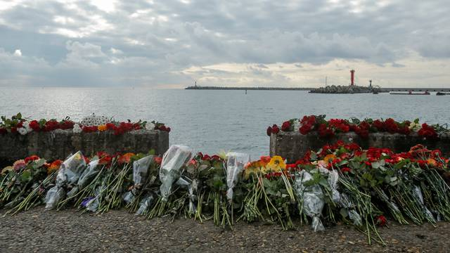 Flowers in memory of passengers and crew members of Russian military Tu-154, which crashed into the Black Sea on its way to Syria on Sunday, are placed at an embankment in the Black Sea resort city of Sochi