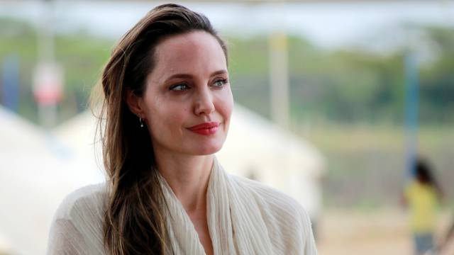 UN Refugee Agency's special envoy Angelina Jolie reacts during a news conference in a camp run by the UNHCR in Maicao