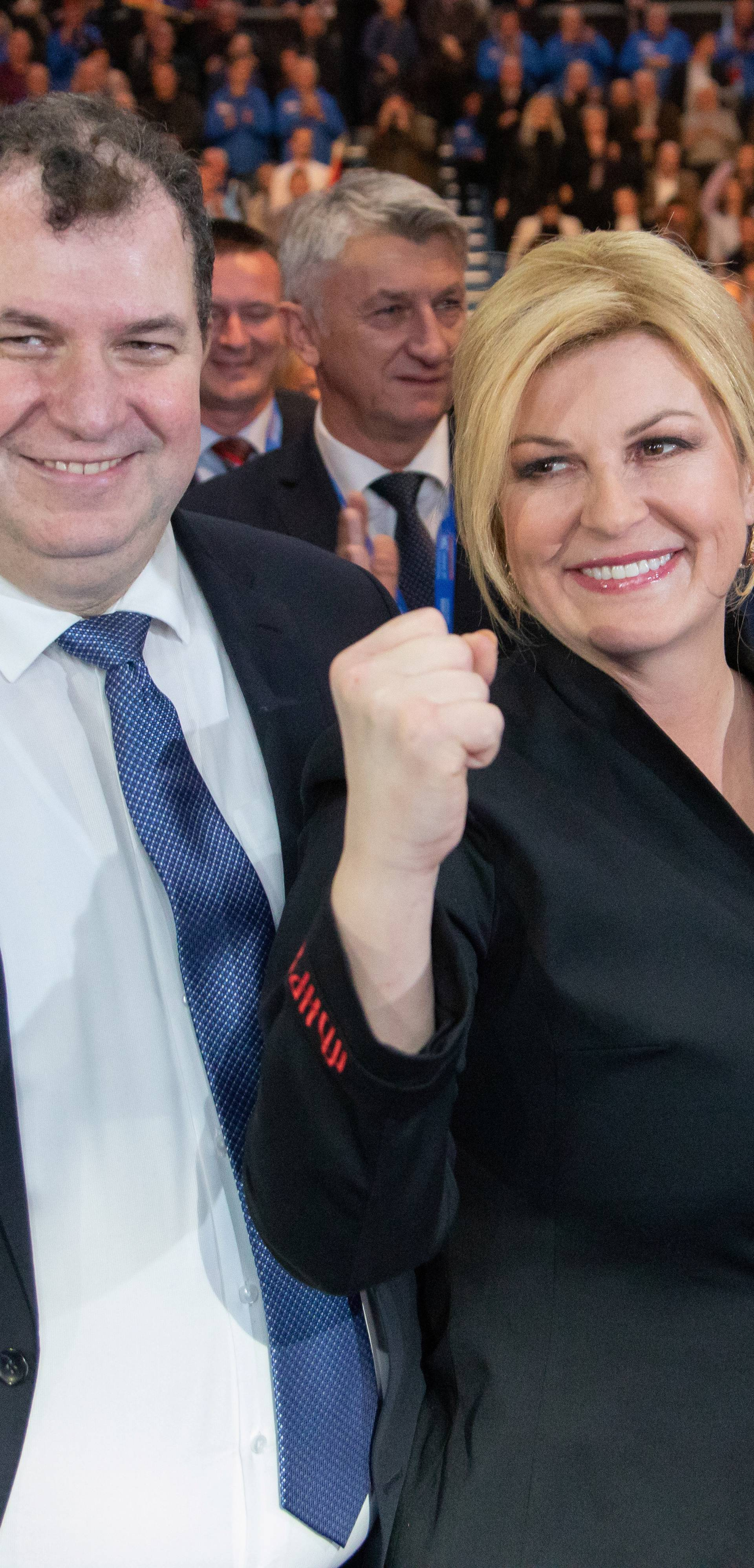 Croatia's President Kolinda Grabar Kitarovic and presidential candidate poses for a picture with her husband Jakov Kitarovic during an election rally at Cibona hall in Zagreb