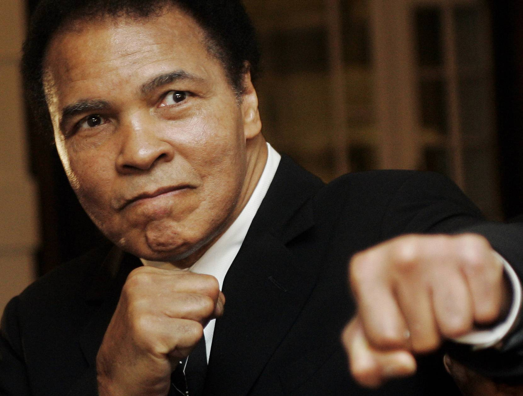 U.S. boxing great Muhammad Ali poses at the World Economic Forum in Davos