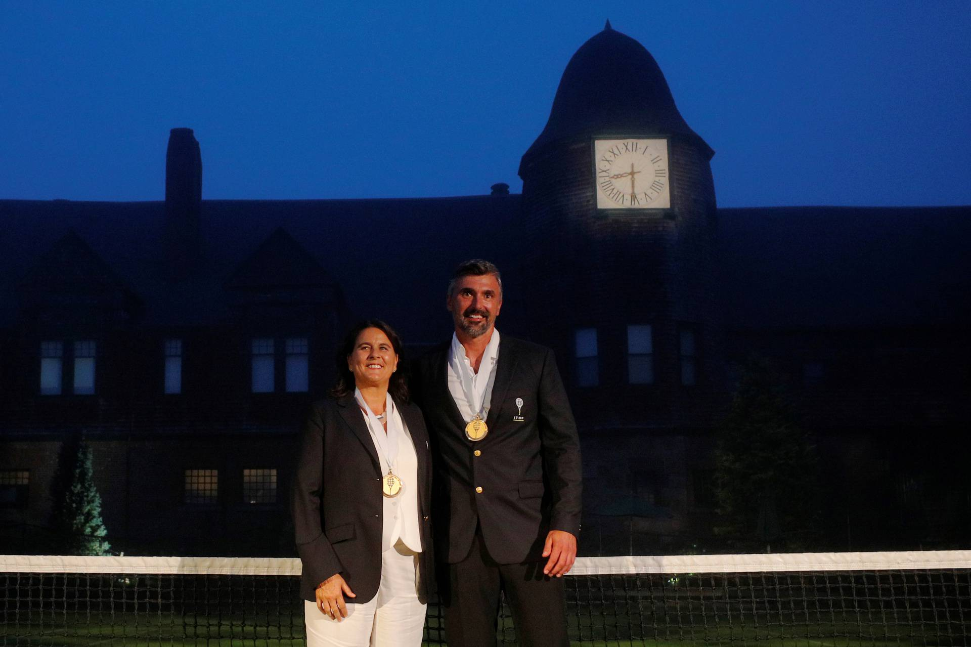 Former tennis players Conchita Martinez of Spain and Goran Ivanisevic of Croatia pose for photographs in Newport