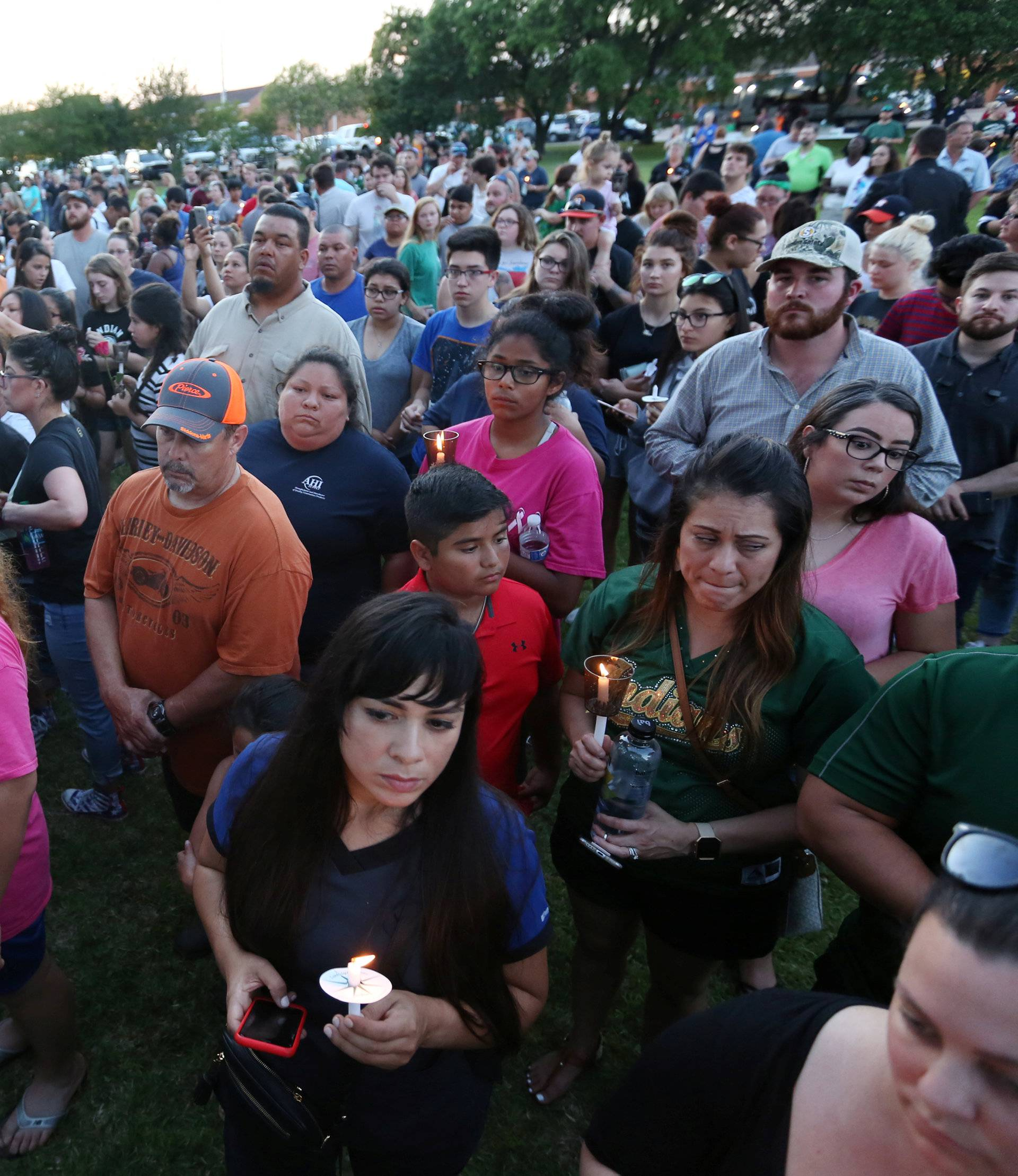 People gather with candles during a vigil held after a shooting left several people dead at Santa Fe High School in Santa Fe, Texas