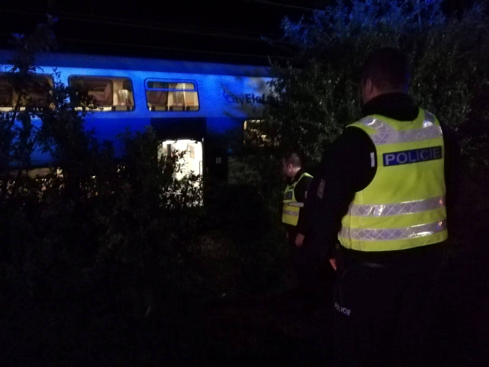 Police officers are seen at the site of a train accident in Cesky Brod