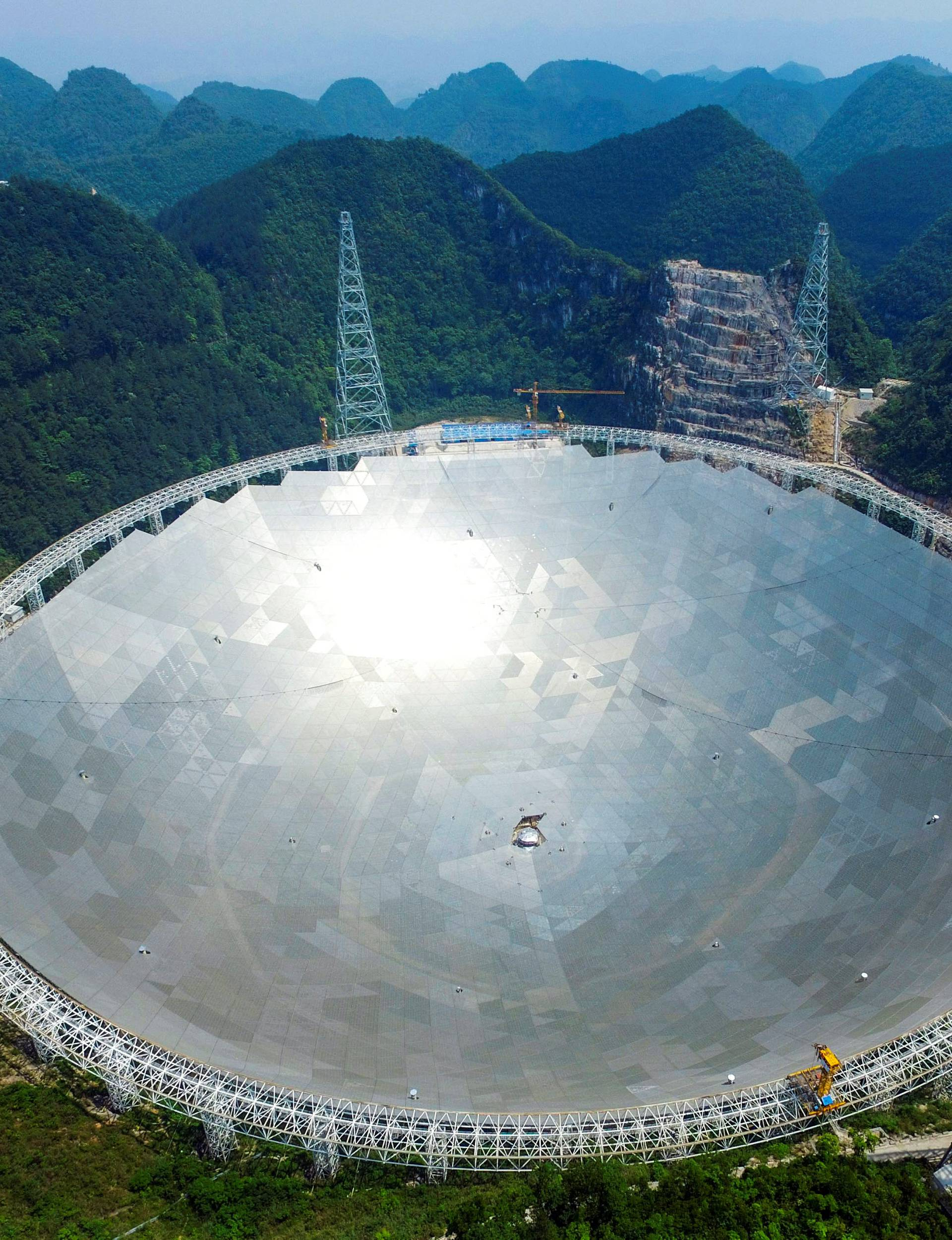 A 500-metre aperture spherical telescopeis seen at the final stage of construction, among the mountains in Pingtang county