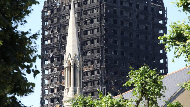 A church spire stands in the foreground of Grenfell Tower in North Kensington, London