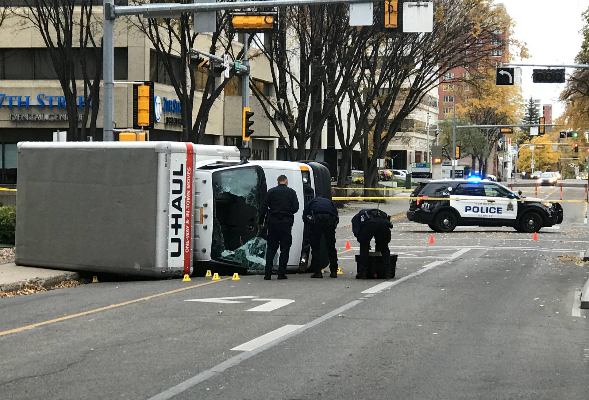 Edmonton Police investigate at the scene where a man hit pedestrians then flipped the U-Haul truck in Edmonton