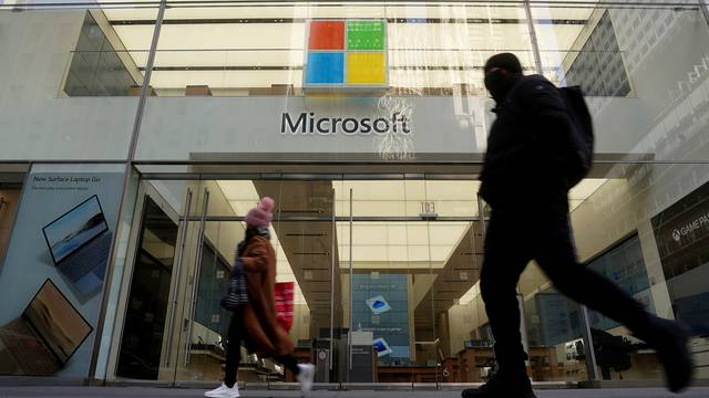 People walk past a Microsoft store in New York
