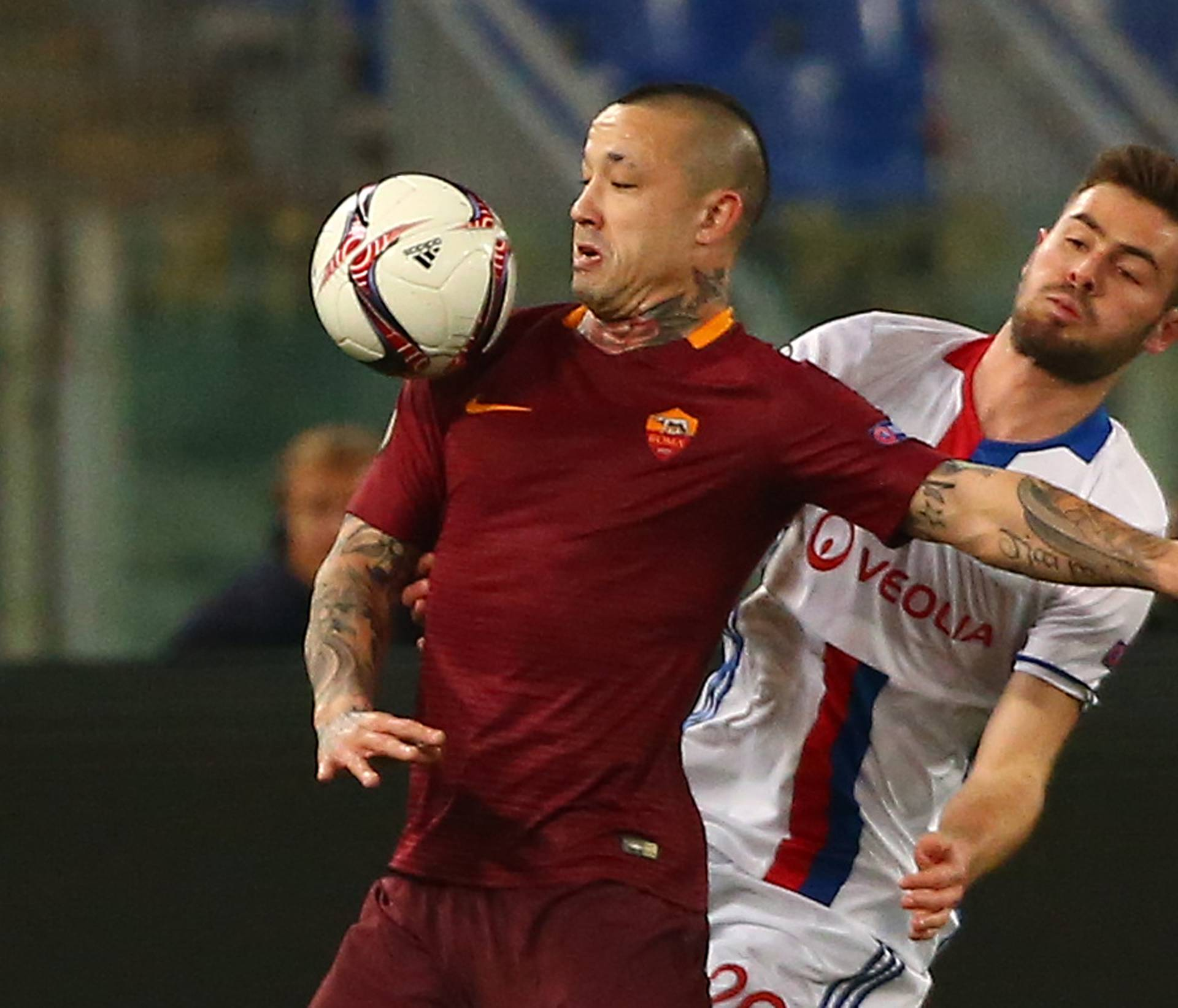 Roma's Radja Nainggolan in action with Lyon's Lucas Tousart