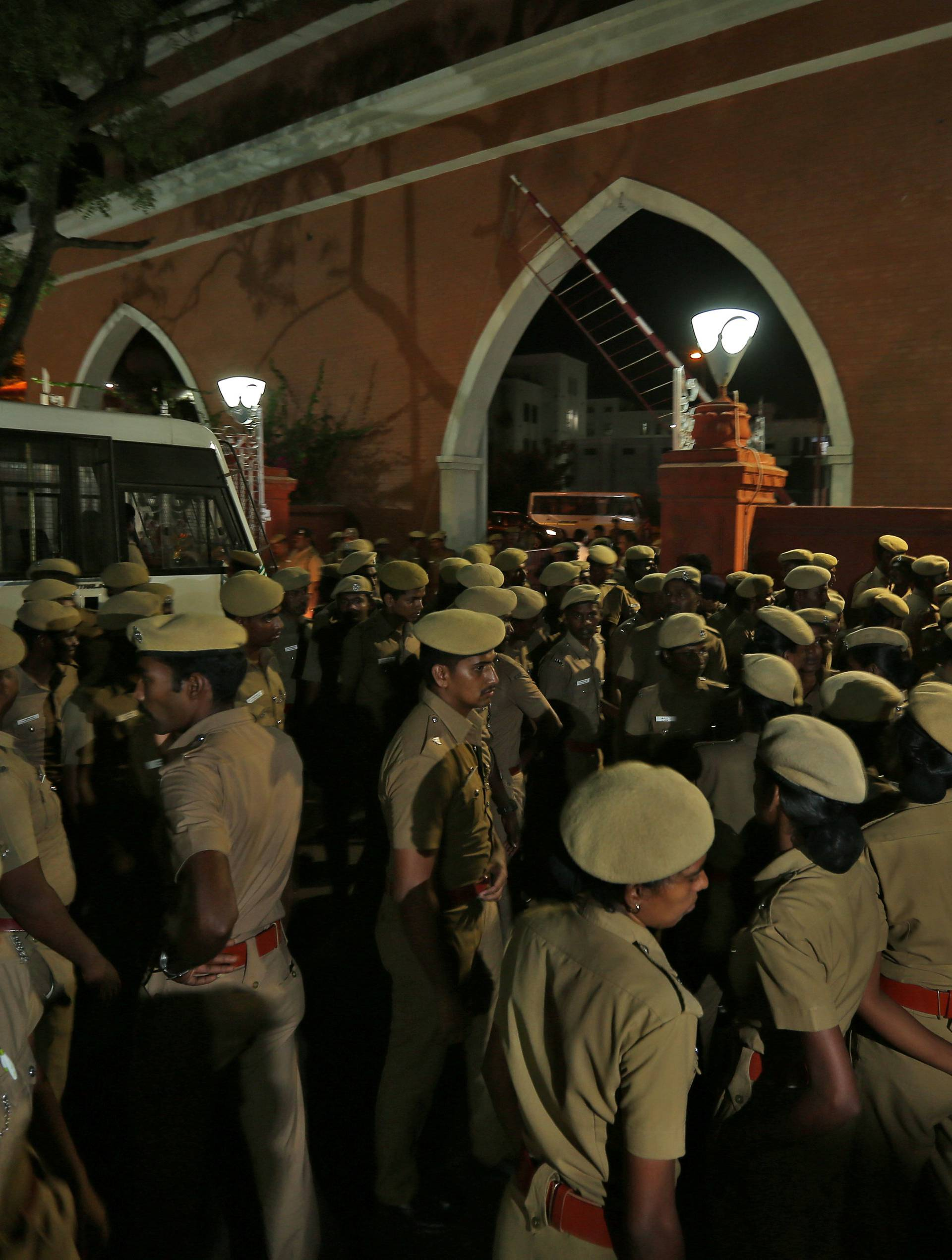Police stand guard inside the high court premises in Chennai