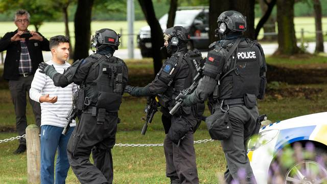 AOS (Armed Offenders Squad) push back members of the public following a shooting at the Masjid Al Noor mosque in Christchurch