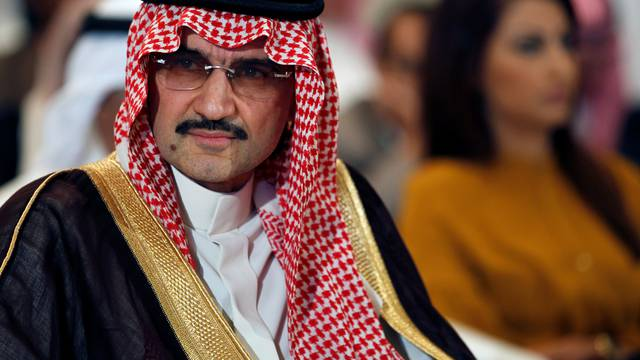 FILE PHOTO - Saudi billionaire Prince AlWaleed bin Talal looks on during a news briefing in Manama