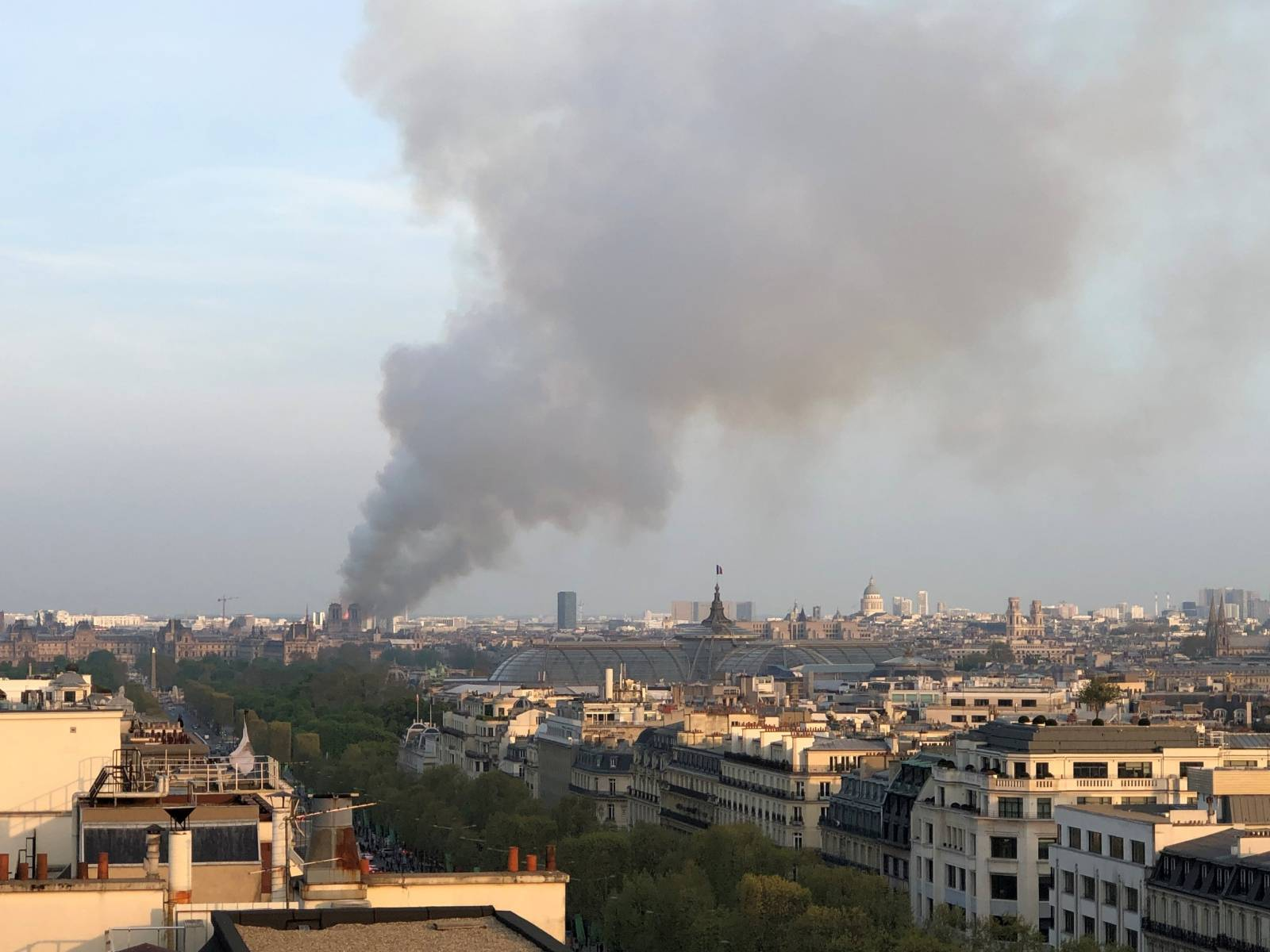 Flames and thick smoke billow from Notre Dame Cathedral in Paris