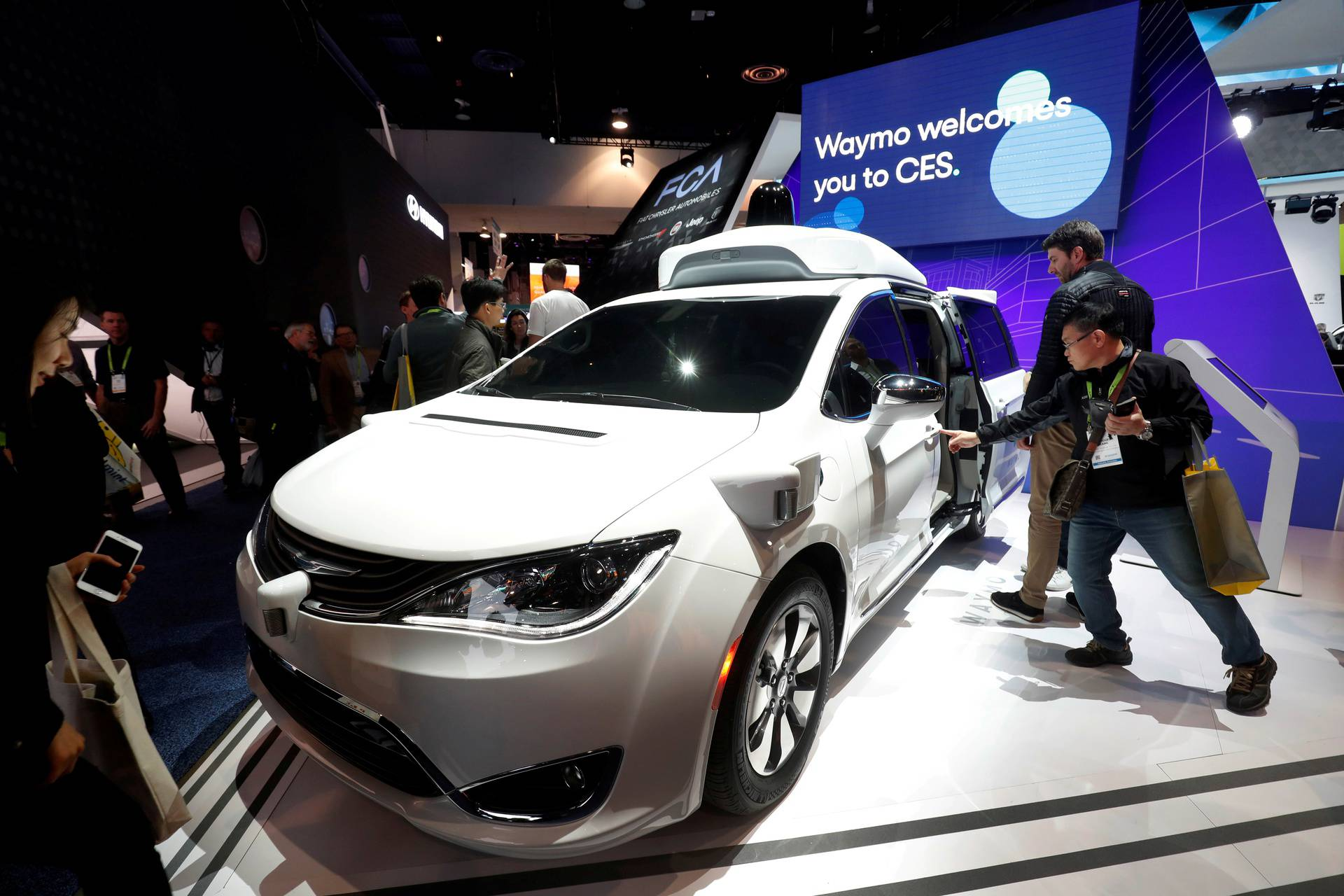 FILE PHOTO: A Waymo autonomous vehicle (formerly the Google self-driving car project) is displayed at the Fiat Chrysler Automobiles booth during the 2019 CES in Las Vegas