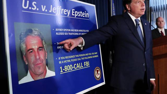 FILE PHOTO: Geoffrey Berman points to a photograph of Jeffrey Epstein in New York