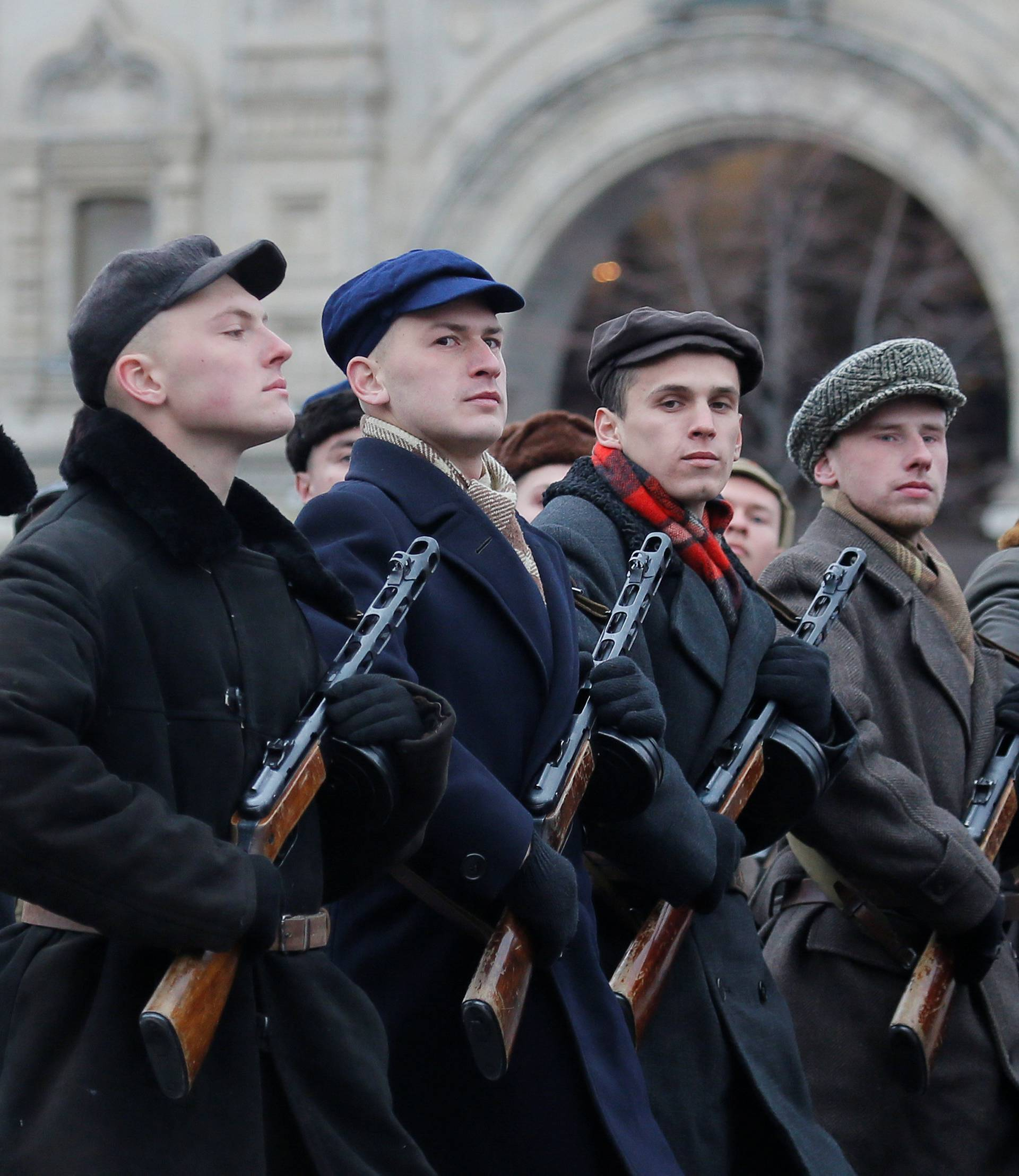 Performers dressed as militia take part in a military parade marking the anniversary of the 1941 parade, when Soviet soldiers marched towards the front lines of World War Two, in Red Square in Moscow