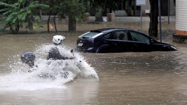A man drives his motorbike during floods after heavy rains, in Humaita neighbourhood, Rio de Janeiro