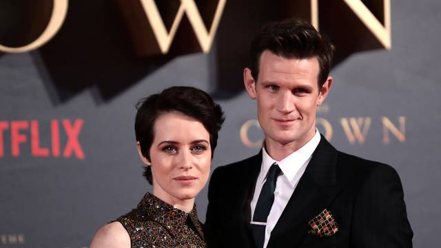 """FILE PHOTO: Actors Claire Foy, who plays Queen Elizabeth II, and Matt Smith who plays Philip Duke of Edinburgh, attend the premiere of """"The Crown"""" Season 2 in London"""