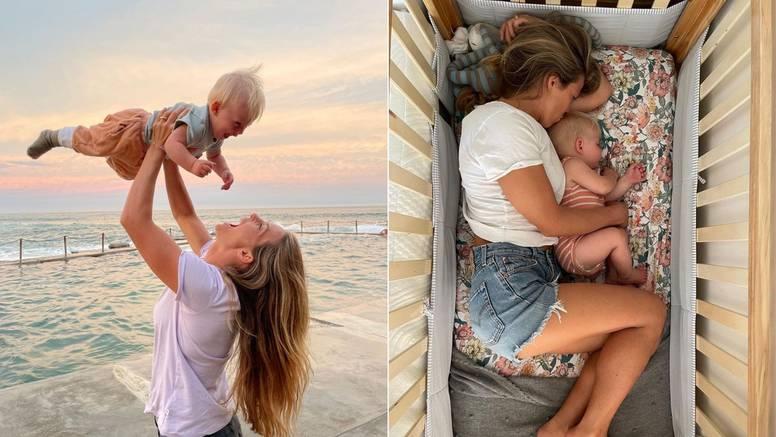Olimpijku izvrijeđali zbog slike dojenja sina dok dubi na glavi