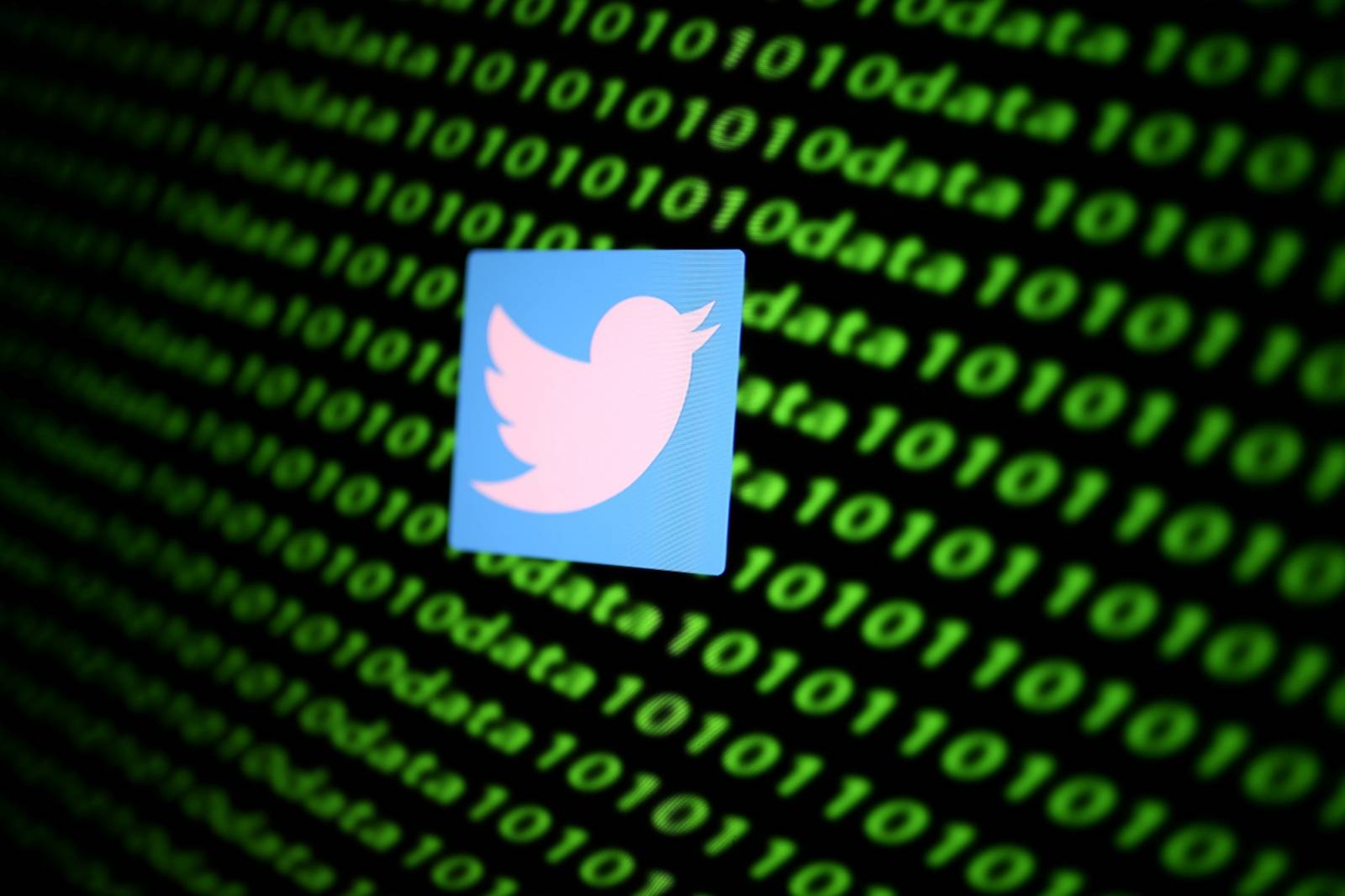FILE PHOTO: The Twitter logo and binary cyber codes are seen in this illustration