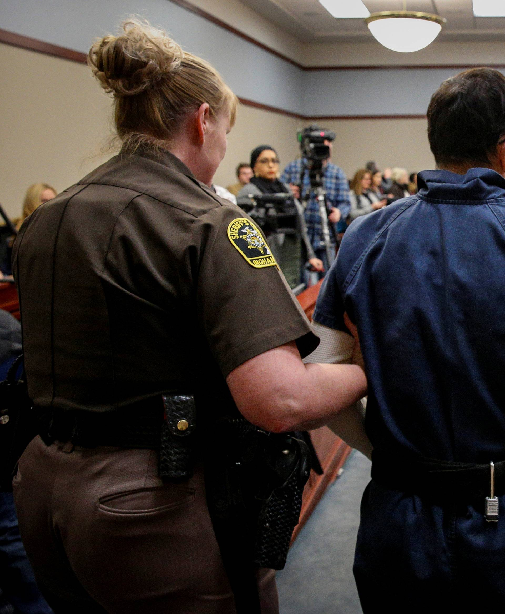 Larry Nassar, a former team USA Gymnastics doctor who pleaded guilty in November 2017 to sexual assault charges, is escorted by a court officer during his sentencing hearing in Lansing, Michigan