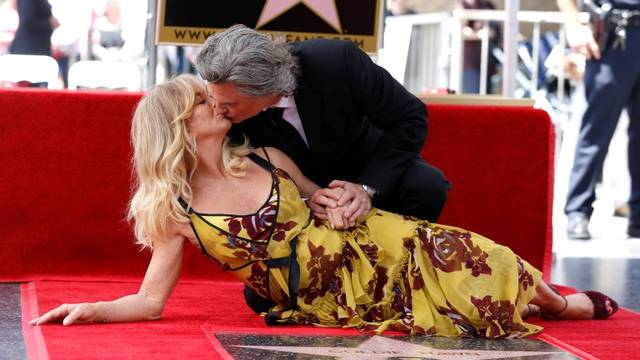 Actors Russell and Hawn kiss after unveiling their stars on the Hollywood Walk of Fame in Los Angeles