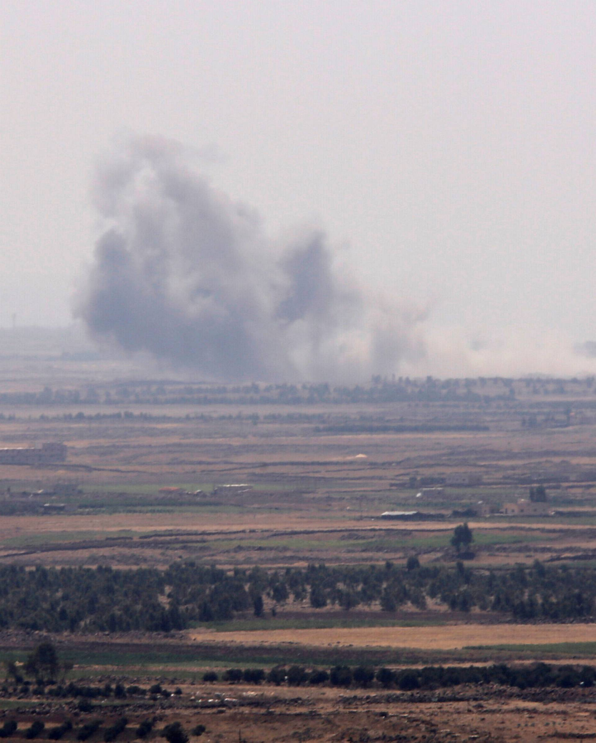 Smoke rises from al Yarmouk valley in Quneitra