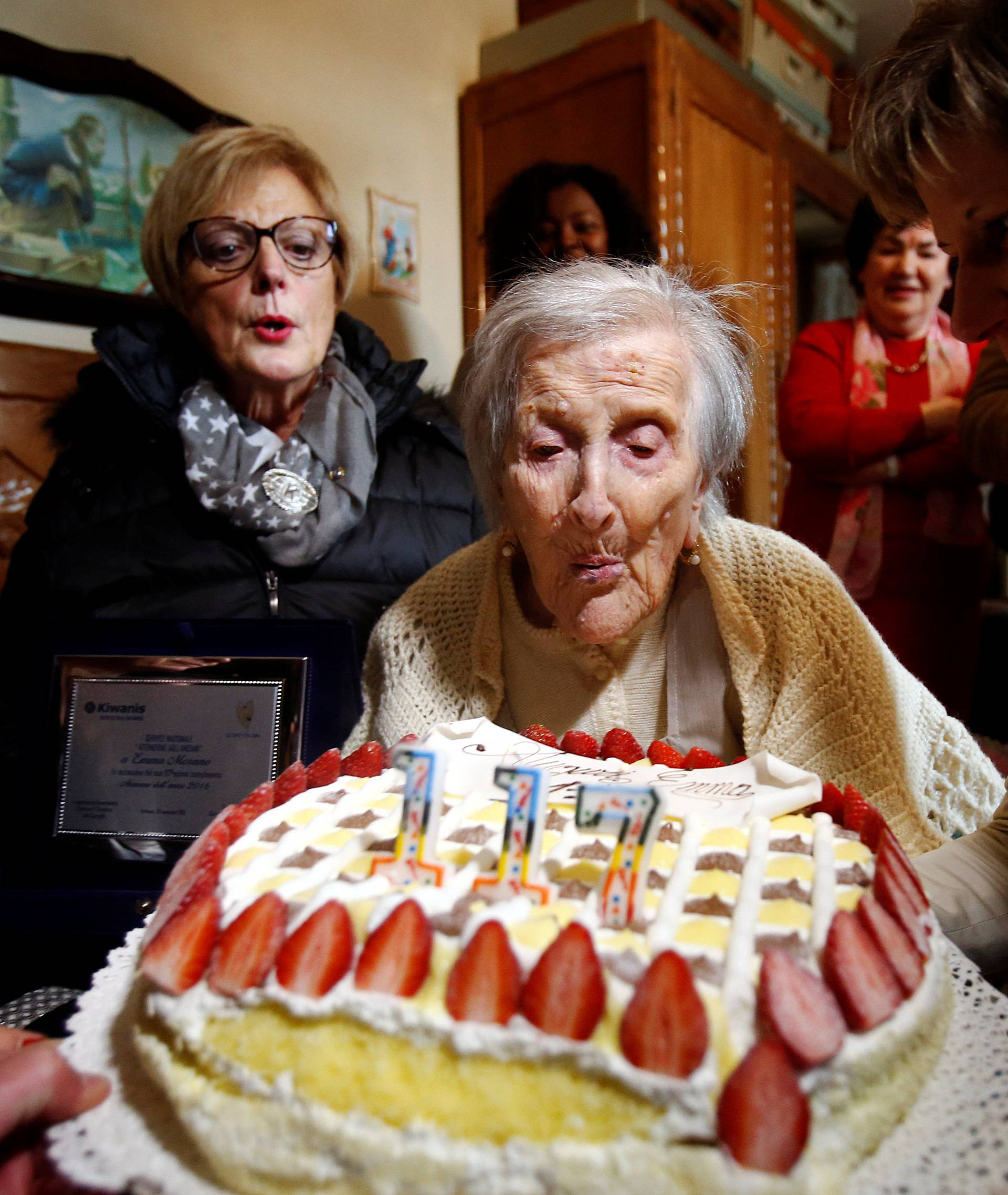Emma Morano, thought to be the world's oldest person and the last to be born in the 1800s, blows candles during her 117th birthday in Verbania