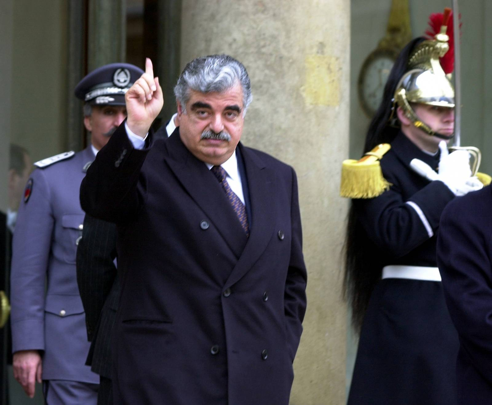 FILE PHOTO: Lebanese Prime Minister Rafik Hariri leaves the Elysee Palace following a meeting with French President Jacques Chirac in Paris