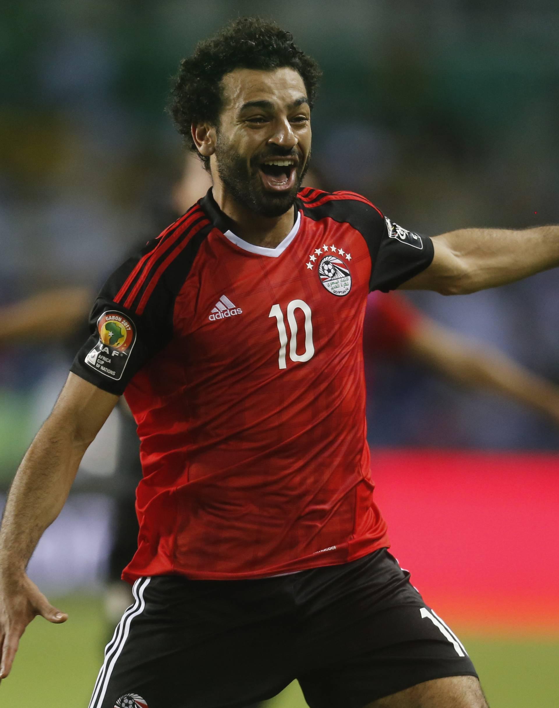 Egypt's Mohamed Salah celebrates after the game