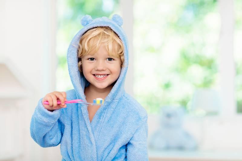 Child brushing teeth. Kids tooth brush.