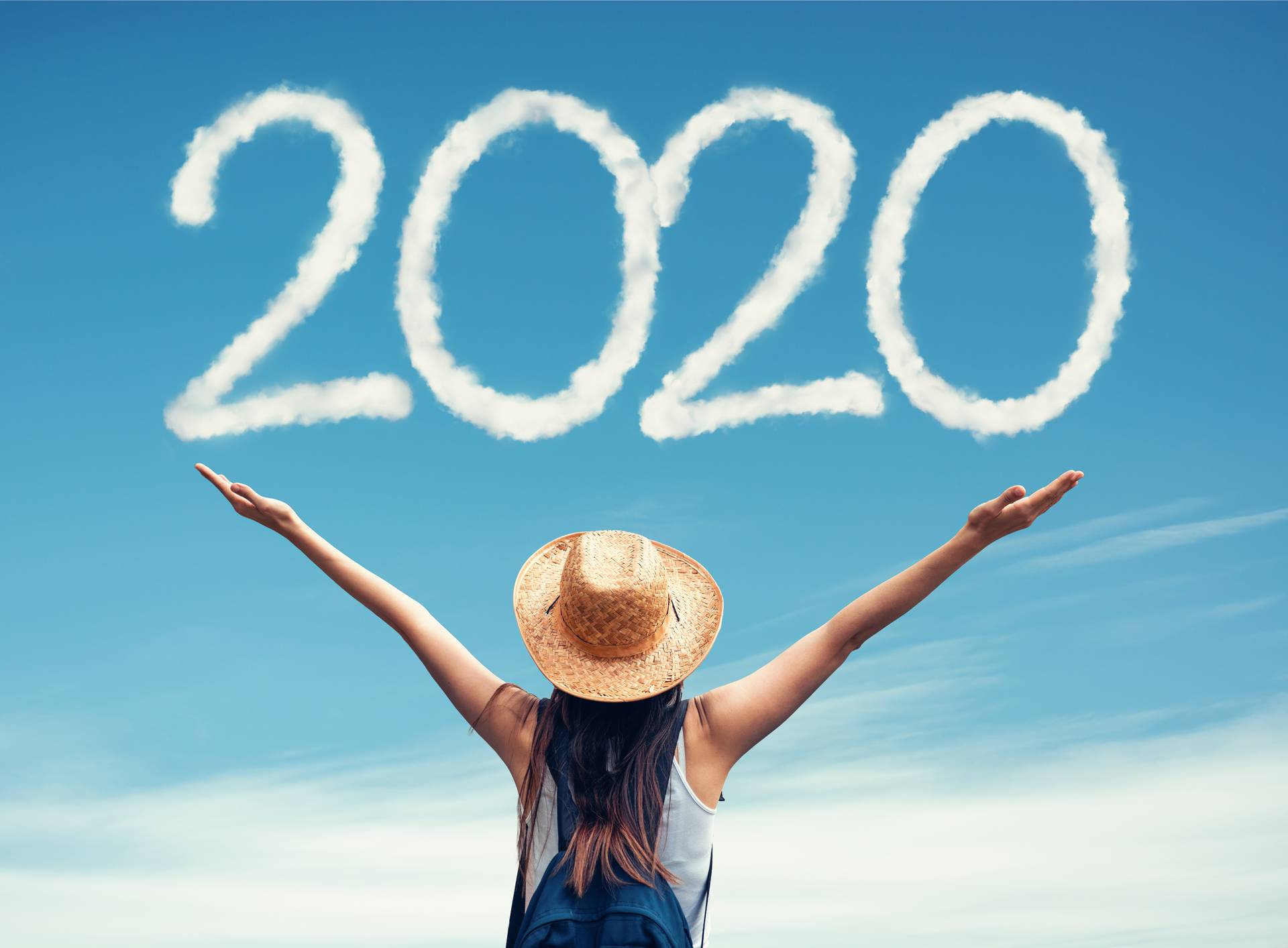 Beautiful woman greets the 2020 portrayaled with clouds