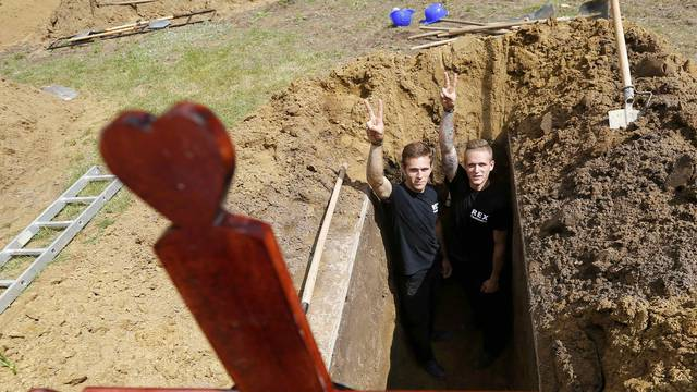 Gravediggers pose after Hungarian grave digging championship in Debrecen