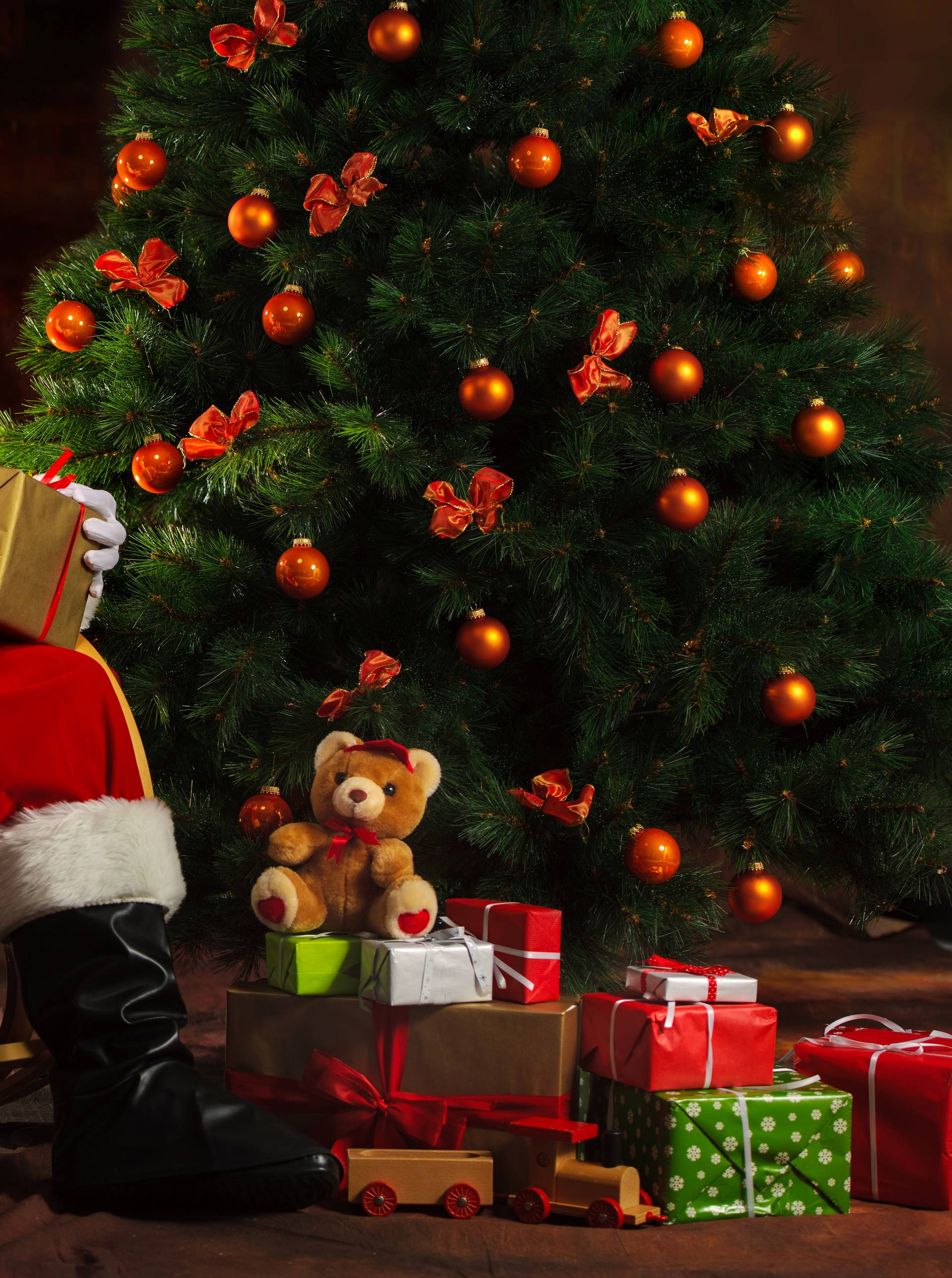 Santa Claus sitting in front of fireplace