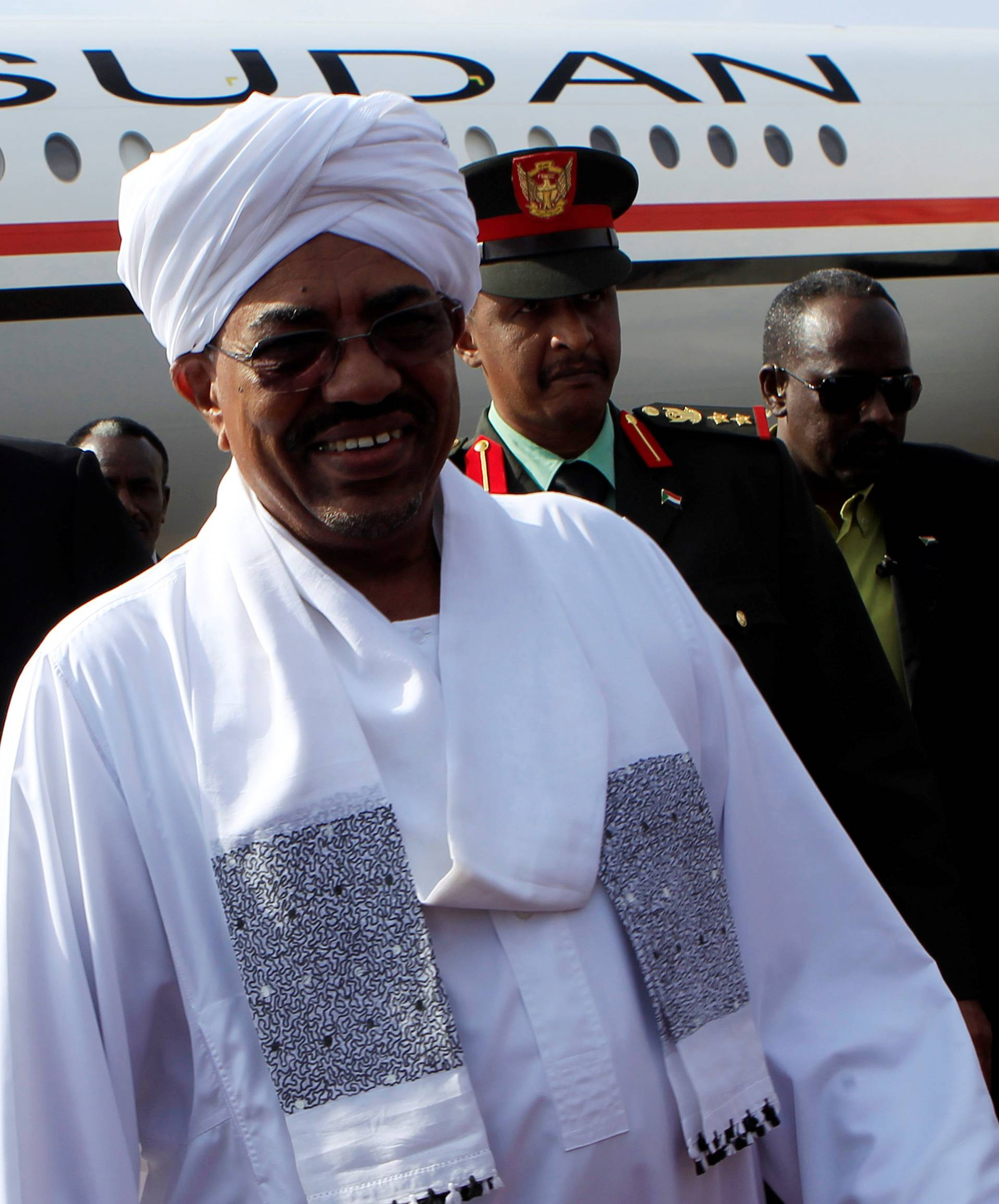 FILE PHOTO: Sudan's President Bashir is welcomed by First Vice President Taha after arriving at Khartoum Airport