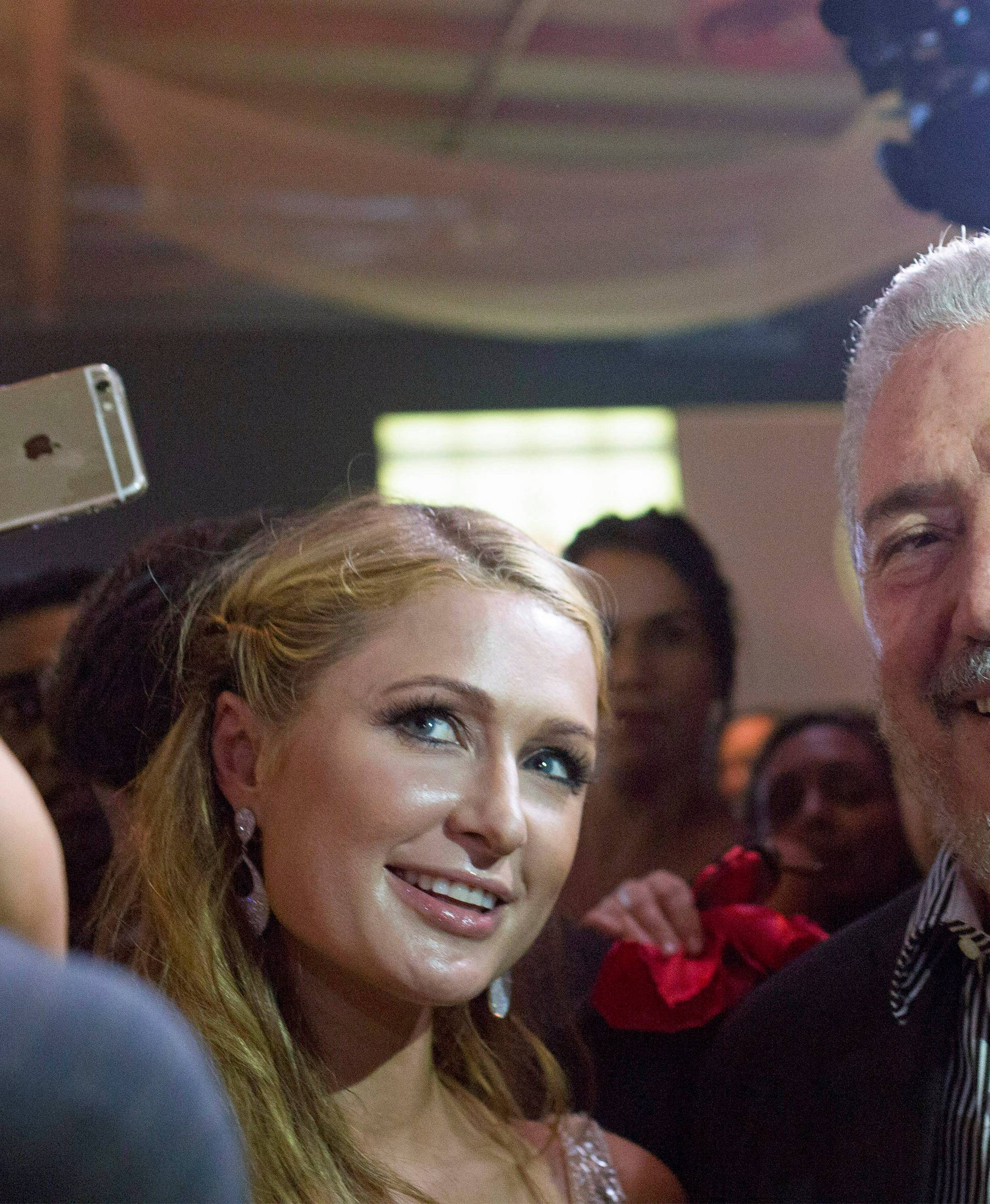 FILE PHOTO: Fidel Castro Diaz-Balart poses with Hilton during the gala dinner of the XVII Habanos Festival, in Havana